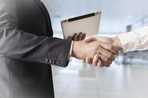 Erfolg im Business Handshake
