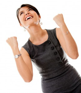 Successful business woman looking very excited - isolated over a white background